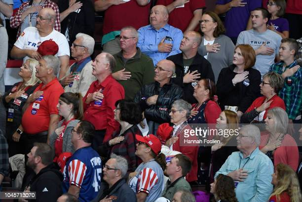 The crowd observes the Pledge of Allegiance at a campaign rally held by US President Donald Trump on October 4 2018 at Mayo Civic Center in Rochester...