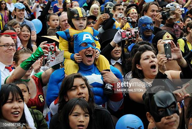 The crowd of 1580 costumed superheroes cheer during the successful attempt to break the Guinness World Record for the largest gathering of...