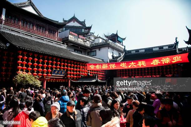 The crowd of believers at the Buddhist temple Chenghuang Miao on February 23 2018 in Shanghai China Since 16 February 2018 the Chinese calendar has...