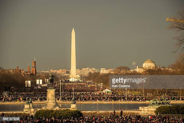 The crowd of people fill the mall for the start of the 57th Inauguration at the US Capitol January 21 2013 in Washington DC Photo Ken Cedeno