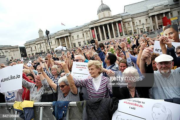 The crowd of people hold hands with each other during a memorial event for murdered Labour MP Jo Cox at Trafalger Square on June 22, 2016 in London,...