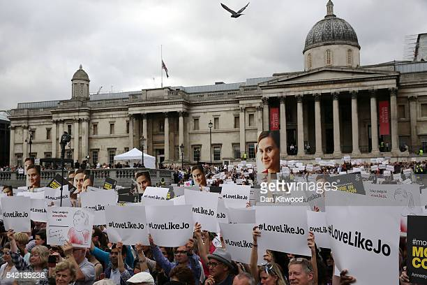 """The crowd of people hold up signs saying """"#LoveLikeJo"""" during a memorial event for murdered Labour MP Jo Cox at Trafalger Square on June 22, 2016 in..."""
