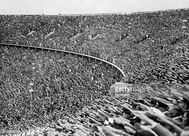 The crowd of spectators at the 1936 Olympic Games in Berlin raises their hands in the Nazi salute in tribute to the Fuhrer's arrival at the stadium