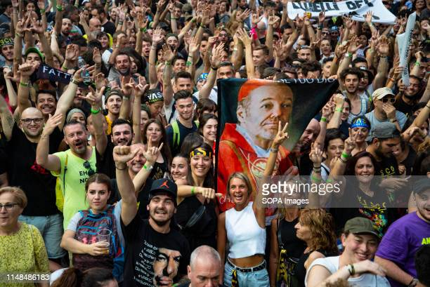 The crowd of the italian rock singer and songwriter Vasco Rossi performing live sold out at San Siro Stadium