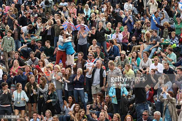 The crowd on Murray Mount celebrates as Andy Murray of Great Britain wins his Gentlemen's Singles quarter final match against David Ferrer of Spain...