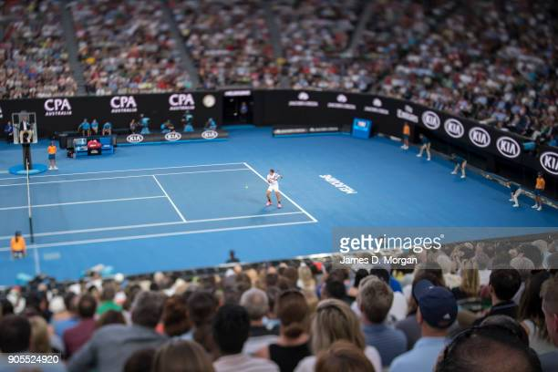The crowd on Rod Laver Arena watch Roger Federer of Switzerland play Aljaz Bedene of Slovenia on day two of the 2018 Australian Open at Melbourne...