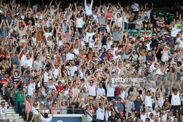 The crowd perform a wave during the Quilter Cup match between England and the Barbarians at Twickenham Stadium on May 27 2018 in London England