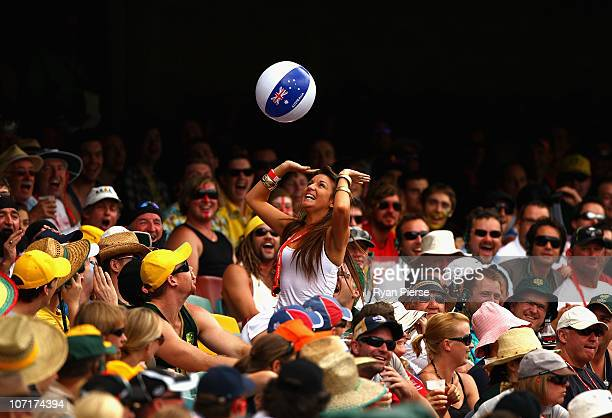 The crowd play with a beach ball during day four of the First Ashes Test match between Australia and England at The Gabba on November 28 2010 in...