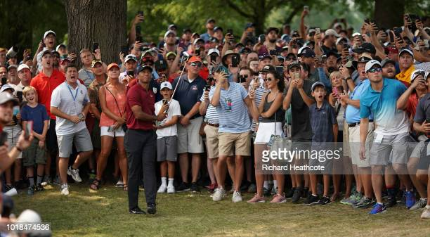 The crowd react as Tiger Woods of the United States plays a shot on the fifth hole during the final round of the 2018 PGA Championship at Bellerive...