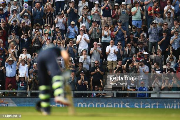 The crowd react to Jos Buttler of England scoring a century during the Second One Day International match between England and Pakistan at The Ageas...
