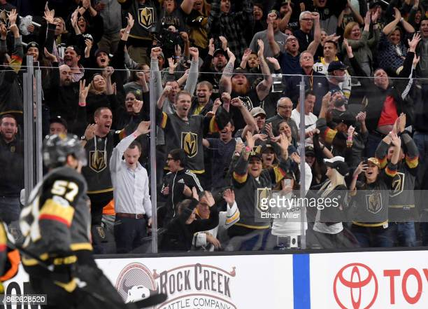 The crowd reacts after David Perron of the Vegas Golden Knights scored a gamewinning goal in overtime against the Buffalo Sabres at TMobile Arena on...