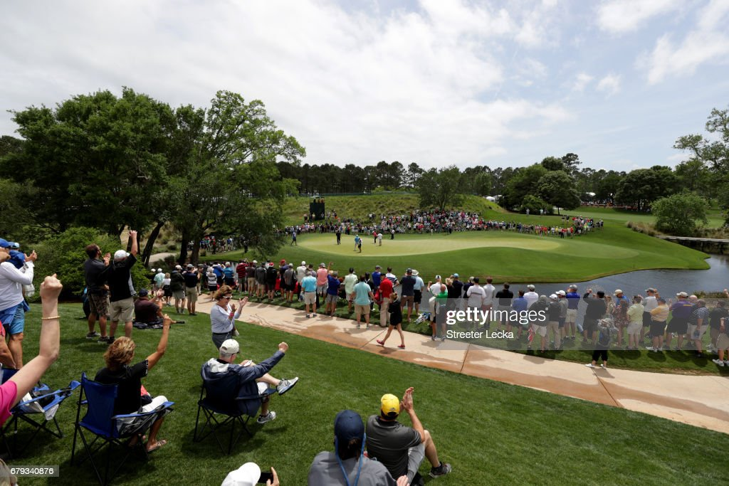 The crowd reacts after Phil Mickelson makes his putt on the second green during round two of the Wells Fargo Championship at Eagle Point Golf Club on May 5, 2017 in Wilmington, North Carolina.