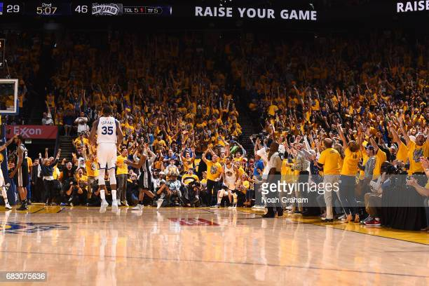 The crowd reacts after Stephen Curry of the Golden State Warriors makes the first threepoint shot of the game during the game against the San Antonio...