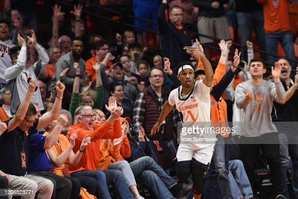The crowd reacts as Illinois Fighting Illini guard Trent Frazier celebrates making a three point basket during the Big Ten Conference college...