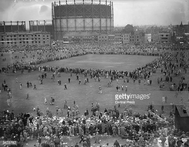 The crowd running onto the pitch at close of play on the final day of the test match between England and Australia at the Oval in South London