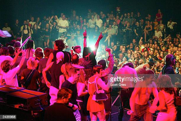 The crowd rushes the stage while Iggy Pop And The Stooges perform during an MTV2 benefit concert event benefitting 'LIFEbeat The Music Industry...