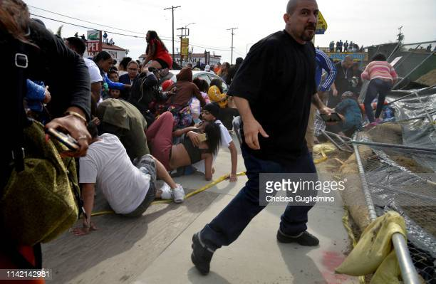 The crowd seen running outside of The Marathon Clothing Store during Nipsey Hussle's Celebration of Life and Funeral Procession on April 11 2019 in...