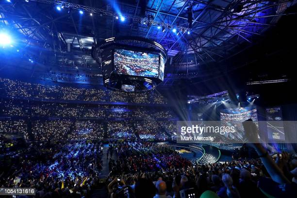 The crowd shine phone torchlights during a performance by Birds of Tokyo the 2018 Invictus Games Closing Ceremony at Qudos Bank Arena on October 27,...