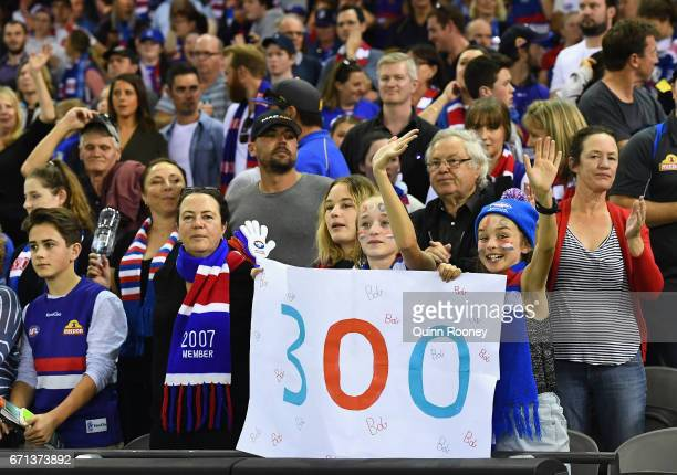 The crowd show their support for Robert Murphy in his 300th game during the round five AFL match between the Western Bulldogs and the Brisbane Lions...