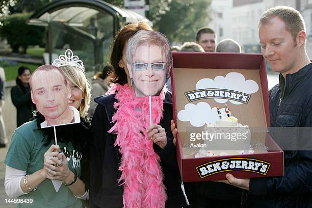 The crowd show their support with facemasks and a celebration cake Sir Elton John David Furnish's civil partnership ceremony The celebrity couple...