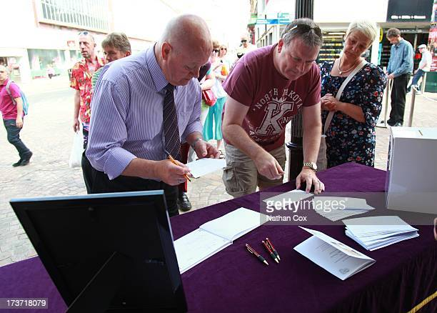 The Crowd signs the book of condolence at Bernie Nolan's funeral at Grand Theatre on July 17 2013 in Blackpool England
