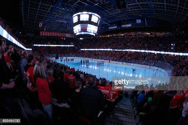 The crowd stands for a moment of silence for the Quebec tragedy before an NHL game between the Calgary Flames and the Minnesota Wild on February 1...