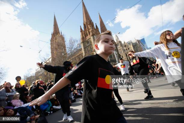 The crowd stop to perform traditional dance during the 2017 NAIDOC March on July 7 2017 in Melbourne Australia The march was organised to call for a...