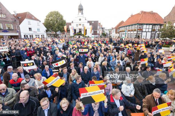 The crowd waits from German chancellor Merkel during an election campaign event on the market place of Lingen Germany 13 September 2017 Signs reading...