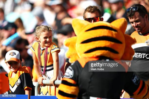 The crowd waits to meet the Tigers mascot during the round one NRL match between the Wests Tigers and the Sydney Roosters at ANZ Stadium on March 10...