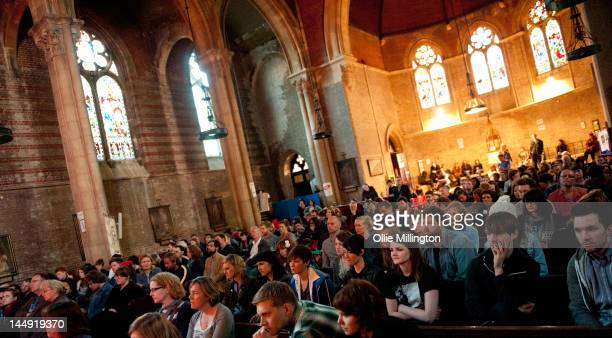 The Crowd watch as Karima Franicis performs on stage at St Mary's Church during the last day of The Great Escape Festiva on May 12 2012 in Brighton...
