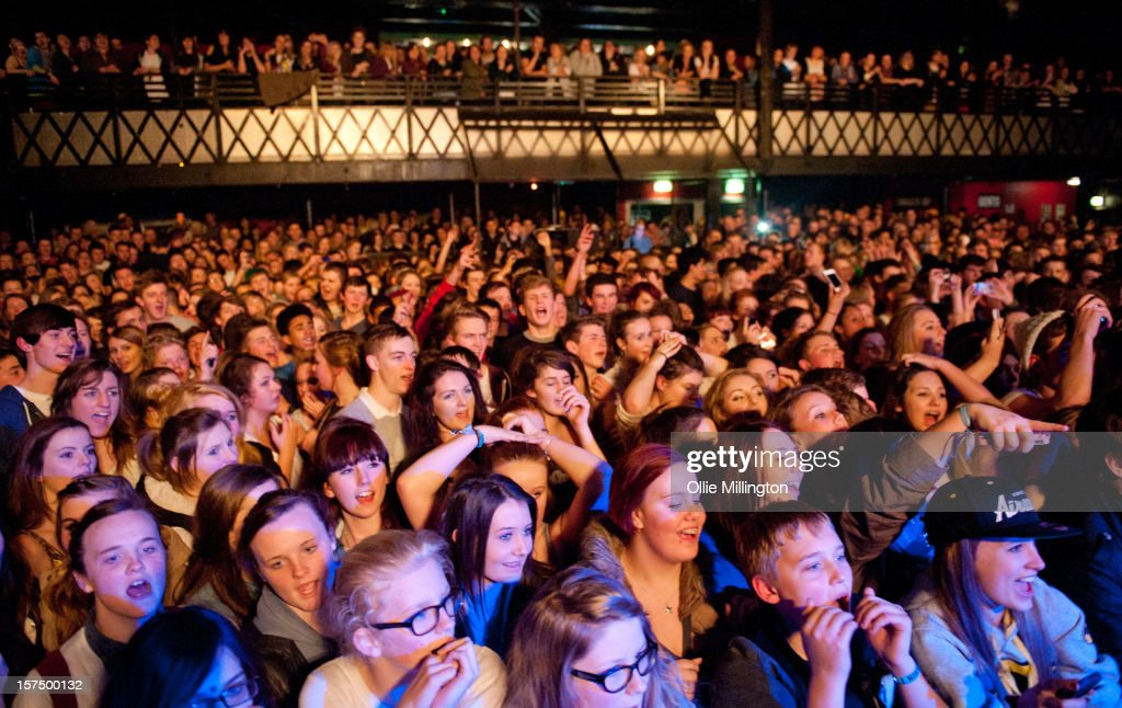 The crowd watch as Rizzle Kicks perform onstage during their December 2012 UK tour at Rock City on December 3, 2012 in Nottingham, England.