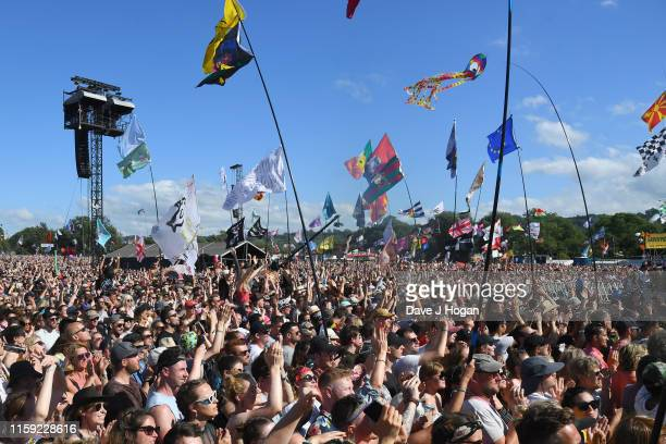 The crowd watch Miley Cyrus performs on the Pyramid stage during day five of Glastonbury Festival at Worthy Farm, Pilton on June 30, 2019 in...