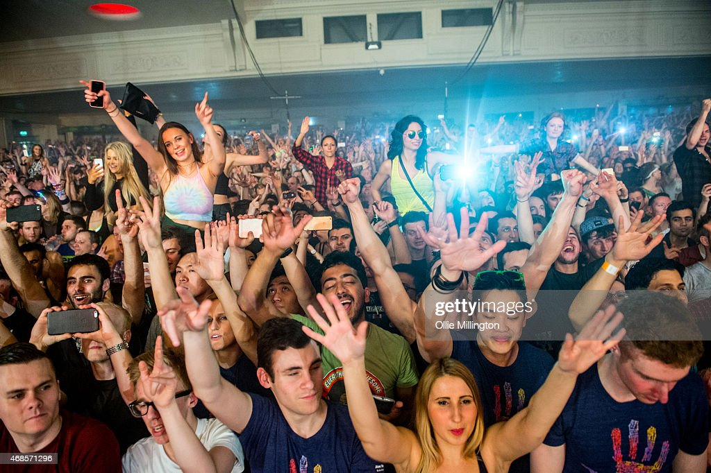 The crowd watch on as Above and Beyond perform on stage during the first of two sold out nights at Brixton Academy on April 3, 2015 in London, United Kingdom.