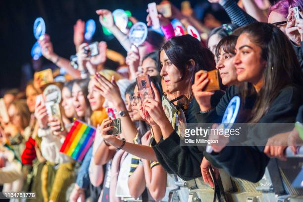 The crowd watch on as Ateez perform on stage at O2 Kentish Town Forum on April 3, 2019 in London, England.