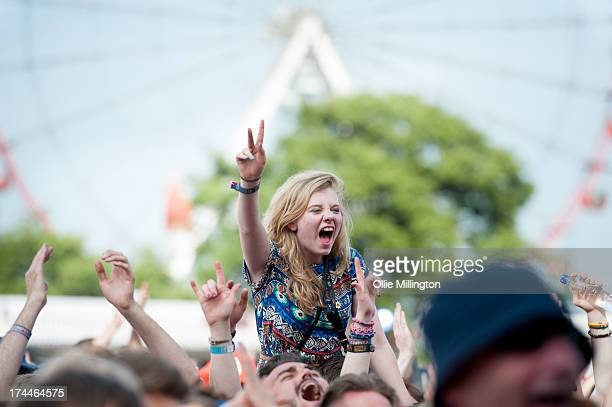The crowd watch on as Haim perform onstage during Day 1 of the T in the Park festival at Balado on July 12 2013 in Kinross Scotland