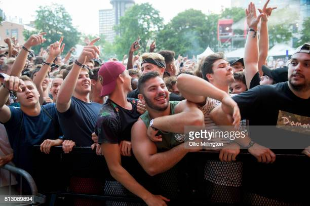 The crowd watch on as Jazz Cartier performs on the Lotto Stage in the Parc de la Francophoni during Day 6 of the 50th Festival d'ete de Quebec on...