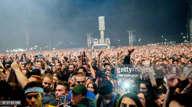 The crowd watch on as Kendrick Lamar performs onstage headlining Day 2 of the 50th Festival D'ete De Quebec on the main stage at the Plaines...