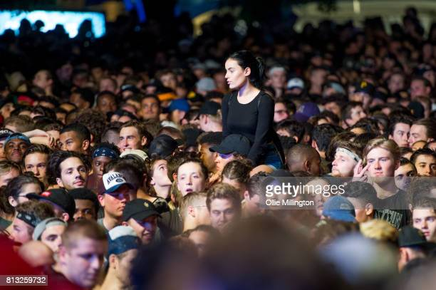 The crowd watch on as Migos performs a headline show on the Lotto Stage in the Parc de la Francophonie during Day 6 of the 50th Festival d'ete de...