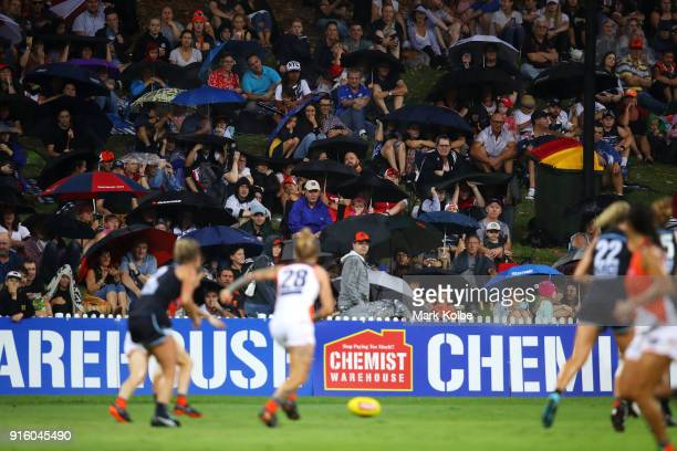 The crowd watch on as rain falls during the round 20 AFLW match between the Greater Western Sydney Giants and the Carlton Blues at Drummoyne Oval on...