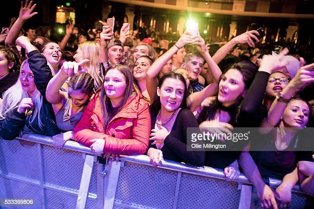 The crowd watch on as Solo 45 of Boy Better Know performs onstage at The Brighton Dome as a special surprise guest performing feed them to the lions...