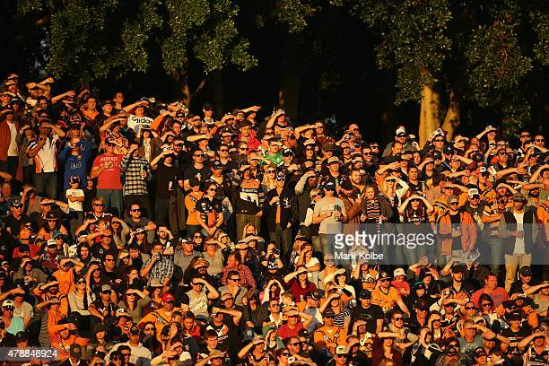 The crowd watch on during the round 16 NRL match between the Wests Tigers and the Penrith Panthers at Leichhardt Oval on June 28 2015 in Sydney...