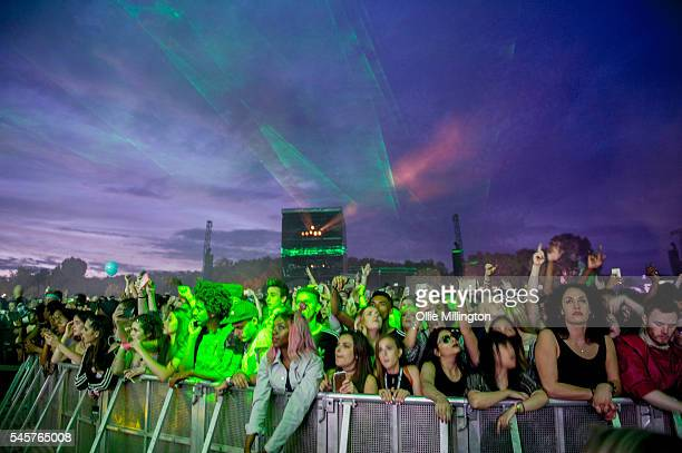 The crowd watch on enjoying the atmosphere during the Chase status headline set at the end of Day 2 of Wireless Festival 2016 at Finsbury Park on...