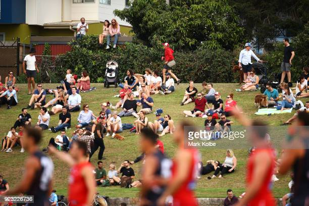 The crowd watch on from the hill during the AFL Inter Club match between the Sydney Swans and the Greater Western Sydney Giants at Henson Park on...