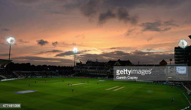 The crowd watch play as the sun sets during the 4th ODI Royal London One-Day match between England and New Zealand at Trent Bridge on June 17, 2015...