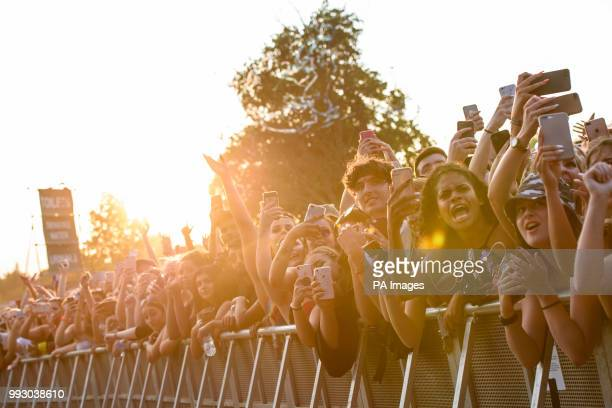 The crowd watch Post Malone performing on the first day of the Wireless Festival in Finsbury Park north London PRESS ASSOCIATION Photo Picture date...