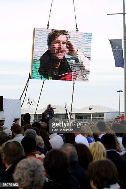 The crowd watches as a moving tribute to sailing legend Sir Peter Blake is played on the big screen during the 2003 America's Cup and Louis Vuitton...