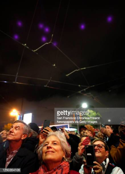 The crowd watches as Harvey's Halo illuminates the sky above Harvey Milk Plaza to celebrate the 40th anniversary of his election to the Board of...