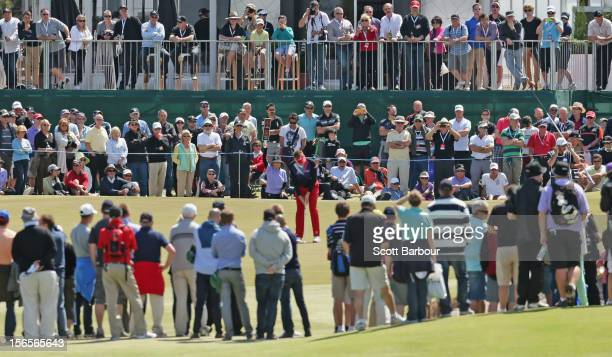 The crowd watches as Ian Poulter of England putts on the 9th hole during day three of the Australian Masters at Kingston Heath Golf Club on November...