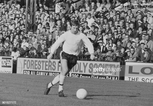 The crowd watches British soccer player Cliff Jones in action on the day of his debut with Fulham FC UK 14th October 1968