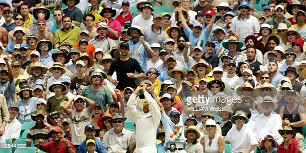 The crowd watches on anxiously as Indian fieldsman Virender Sehwag catches Australian batsman Simon Katich on the fourth day of the fourth Test Match...
